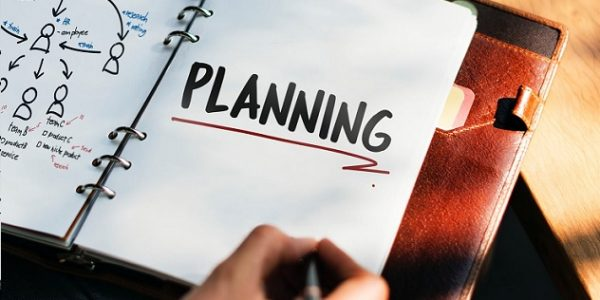 notebook with the word 'planning' written on a page
