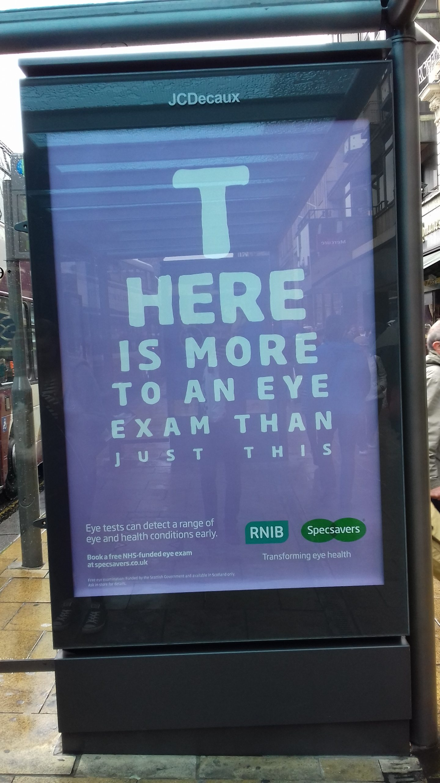 Photo of a bus stop Specsavers advert